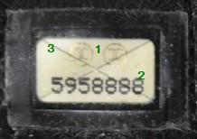 43ff34fd7914  1  Point 1 is indicating where the gold Chanel interlocking c logos should  be found. Notice that they are centered between the series number.